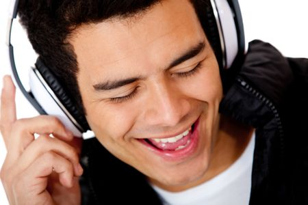 Male DJ singing and wearing headphones - isolated over a white background