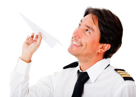 Handsome pilot with a paper airplane - isolated over a white background