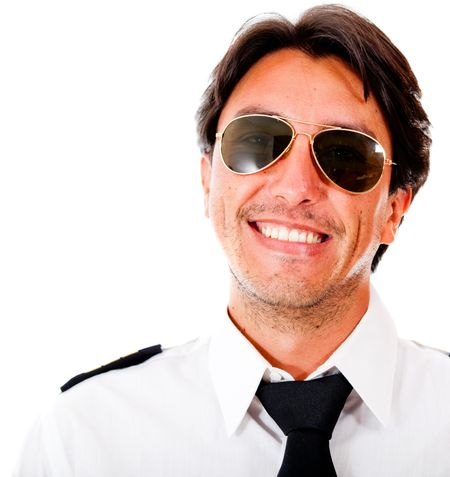 Handsome male pilot smiling - isolated over a white background