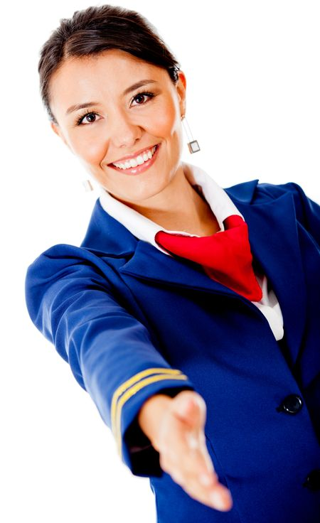 Welcoming air hostess with hand extended �¢?? isolated over a white background