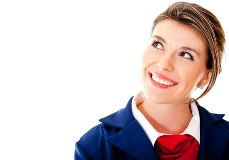 Pensive air hostess looking up - isolated over a white background