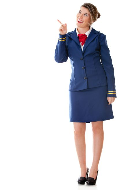 Flight attendant pointing with her finger - isolated over a white background