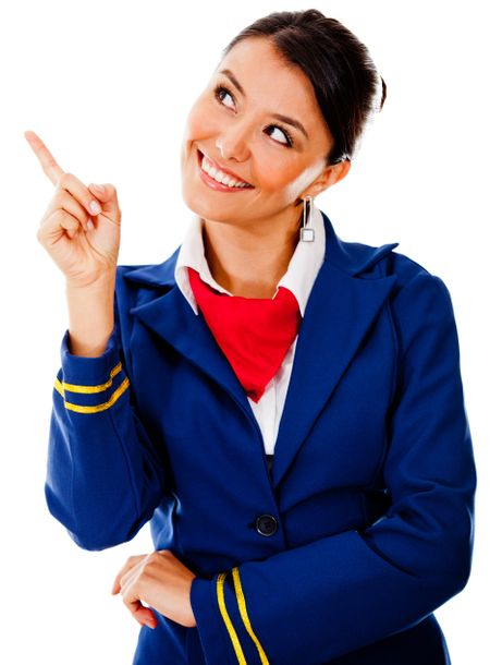Beautiful flight attendant pointing with her finger - isolated over a white background
