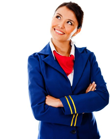 Thoughtful flight attendant looking up - isolated over a white background