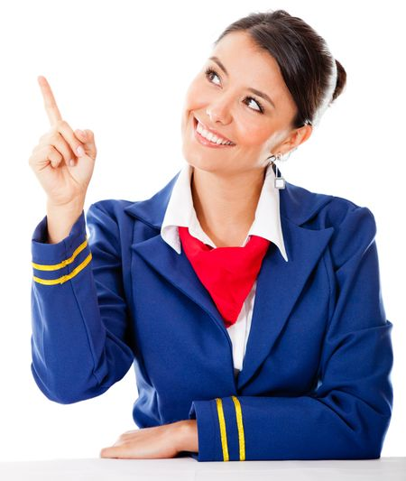 Air hostess pointing with finger �¢?? isolated over a white background