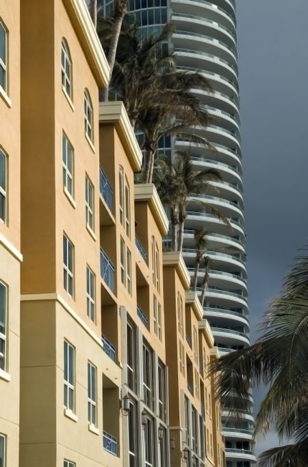 Low-rise and high-rise condominiums sunlit on rainy day