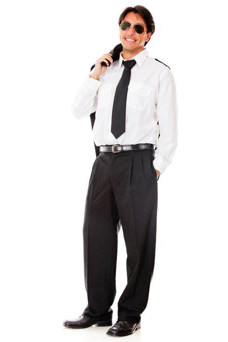 Confident male pilot in uniform - isolated over a white background