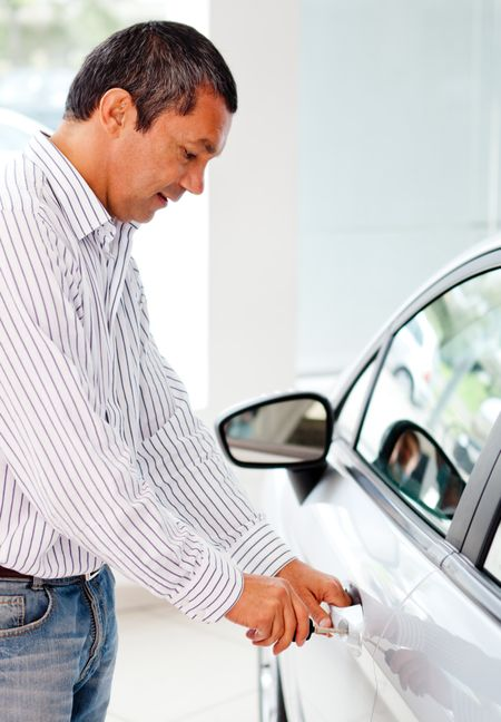 Man opening a car with his key