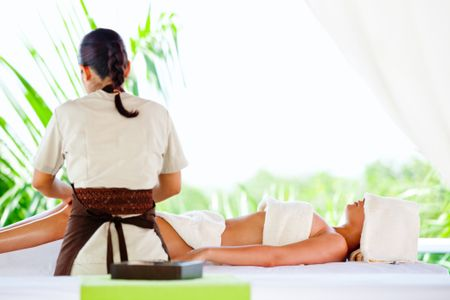 Woman getting a massage on her body at the spa