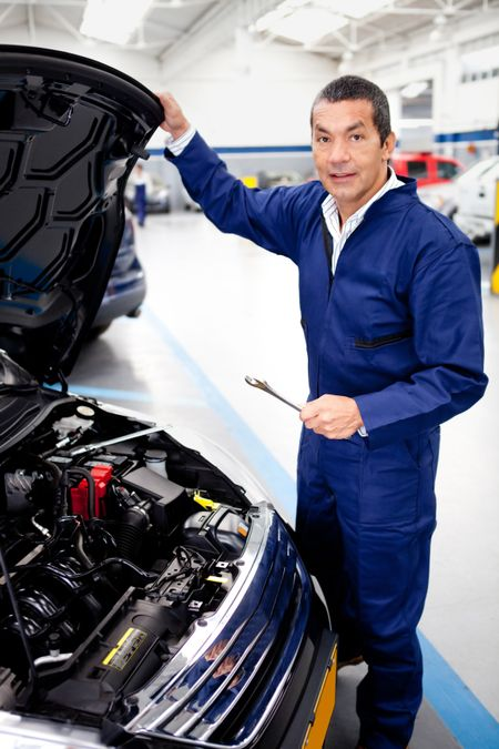 Mechanic fixing the engine of a car