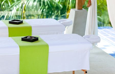 Beautiful spa setting with two beds outdoors
