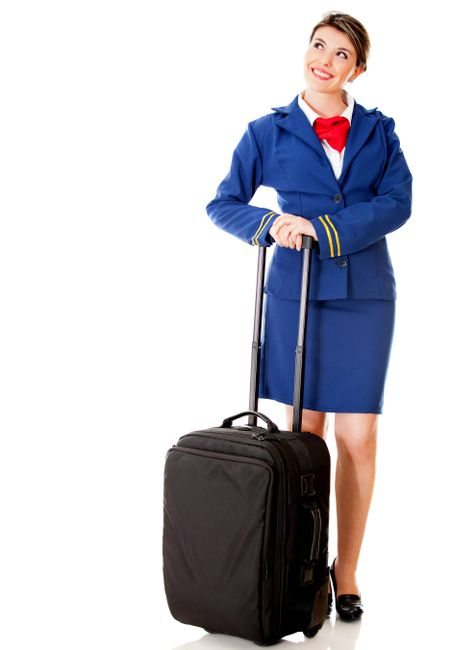 Flight attendant with her bag looking up - isolated over a white background