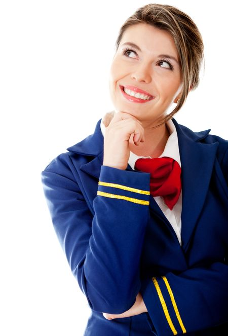 Pensive flight attendant looking up - isolated over a white background