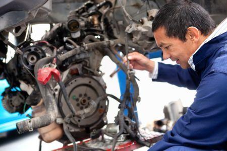 Mechanic fixing a car at the repair shop