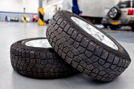 Car tires or wheels at an auto repair shop