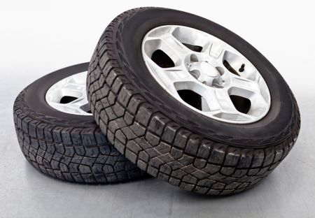 Car wheels or tires lying on the floor