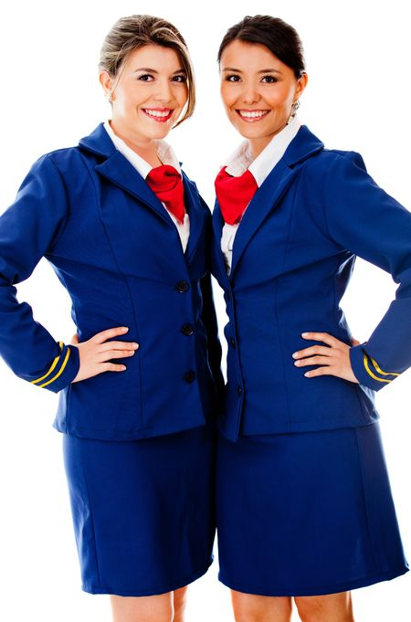 Beautiful air hostesses smiling - isolated over a white background