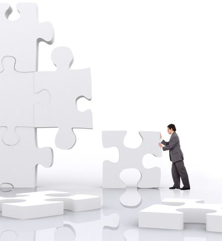 business man implementing a piece of a puzzle
