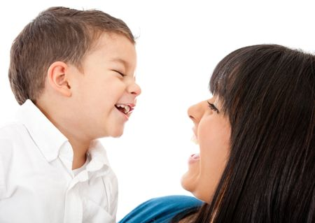 Portrait of a happy mother and son laughing - isolated over a white background