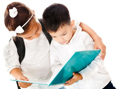 Preschool kids holding a notebook - isolated over a white background