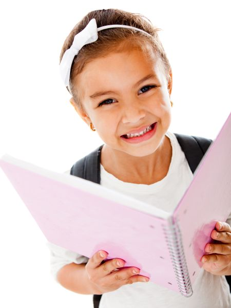 Primary school girl holding a notebook - isolated over a white background