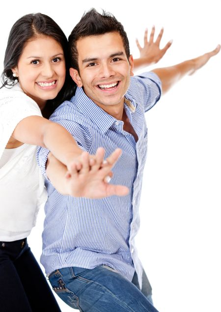 Happy couple with arms open - isolated over a white background