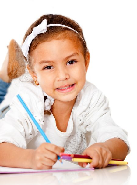 Beautiful girl coloring a book - isolated over a white background