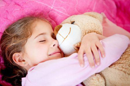 e9c3d0653de7 Cute little girl sleeping with a teddy bear | Freestock Photos