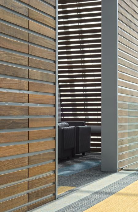 Conversation corner: Shaded nook off sunlit hallway in convention center