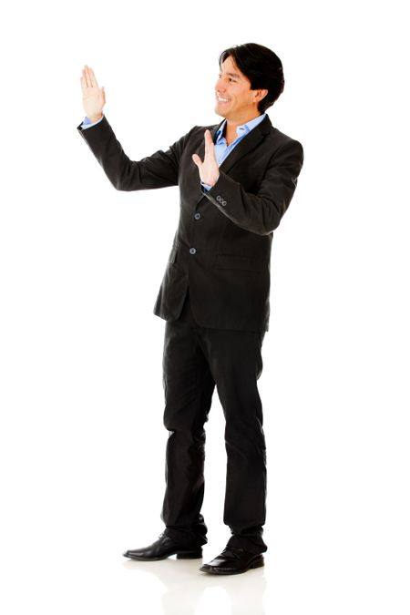 Businessman touching imaginary object with hands - isolated