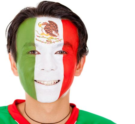 Portrait of a man with the Mexican flag painted on his face