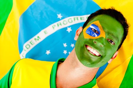 Happy man with the Brazilian flag painted on his face