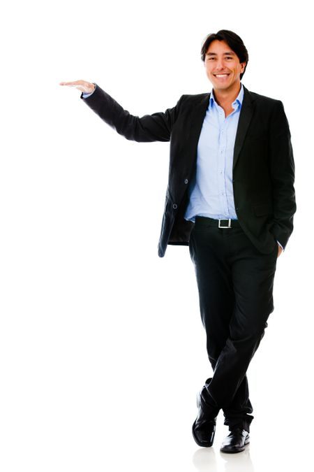 Business man with arm extended - isolated over a white background