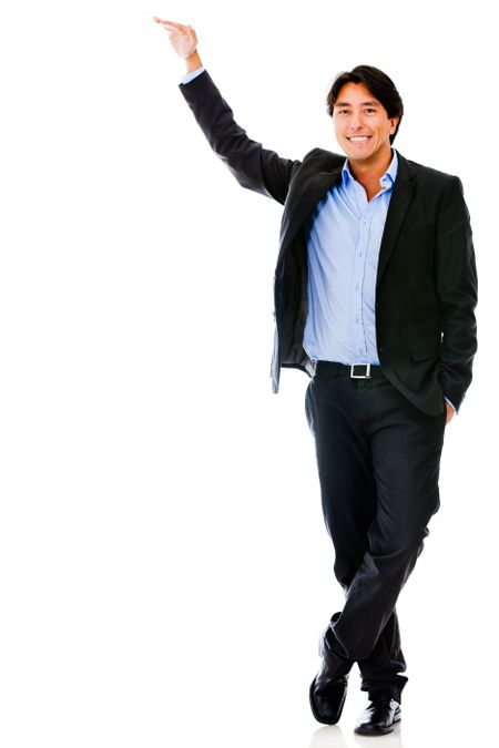 Business man with hand on a tall imaginary object - isolated over white