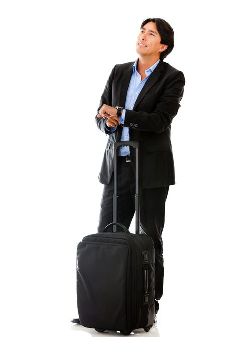 Business man on a trip waiting for his flight - isolated over white