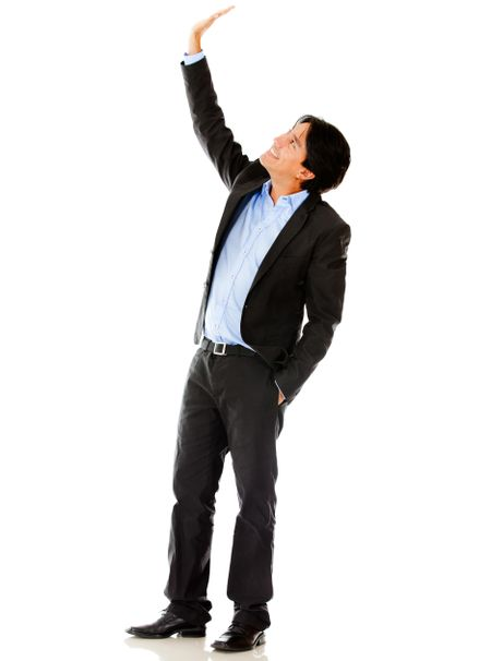 Businessman lifting one arm - isolated over a white background