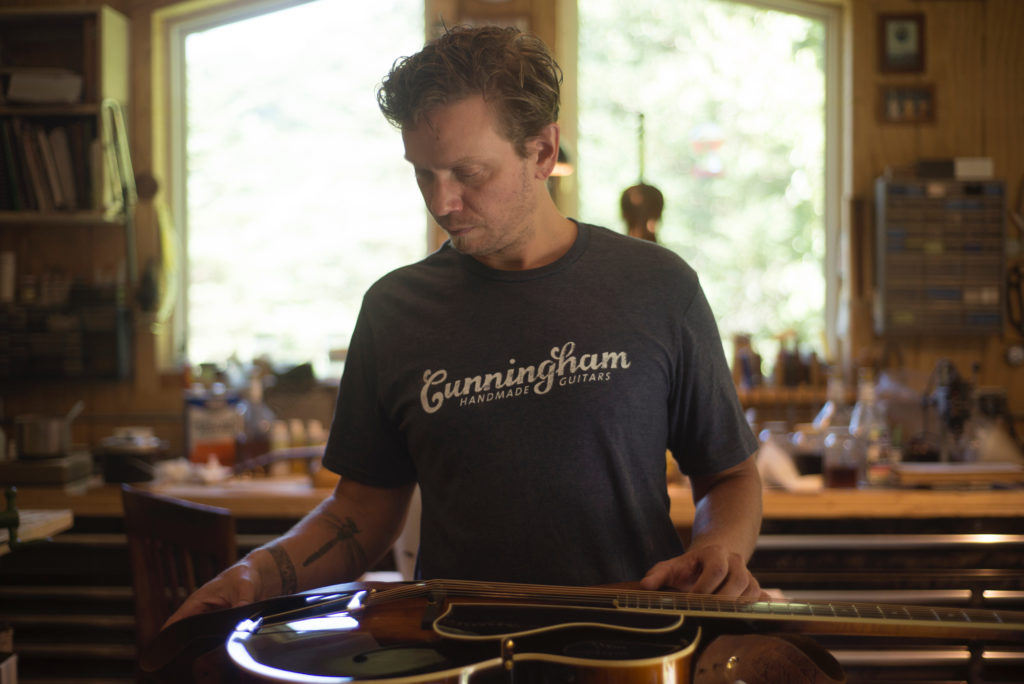 Luthier Jackson Cunningham of Cunningham Hand-Made Instruments makes archtop guitars and fiddles at his workshop in Troutdale, Virginia. Cunningham photographed on 9/3/16. Photo by Pat Jarrett/The Virginia Folklife Program