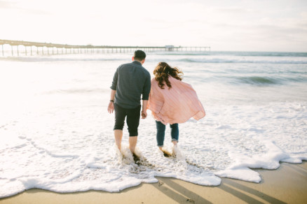 Cuddling on the Ocean Beach Shoreline – Photo by Let's Frolic Together