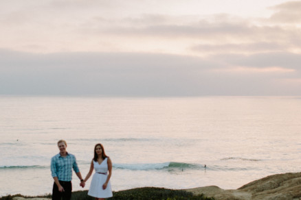 Snuggly Sunset Cliffs Engagement – Photo by Let's Frolic Together