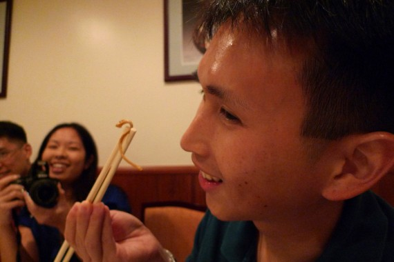"""Ryan Hew eating the """"caterpillar"""" from the caterpillar fungus soup at Canton"""