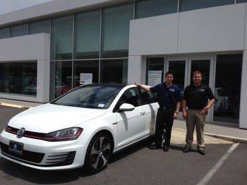 Vince Leong handing me the keys to the Volkswagen GTI