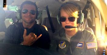 "Bradley Cooper, Emma Stone and a shaka in ""Aloha."""