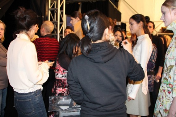Vivienne Tam takes a last look at the models in the line-up before the show.