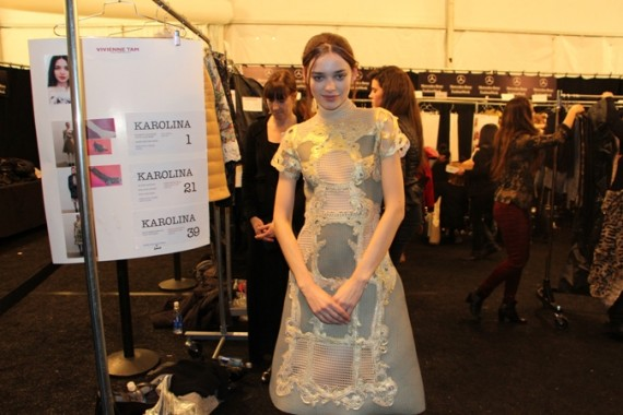 Backstage with model Karolina who was first in the line-up. She's pictured next to her model card and changing area.