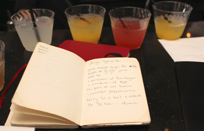 Ackrill keeps her recipes in these two bound notebooks. Yes, those are some of the drinks we sampled in the background.
