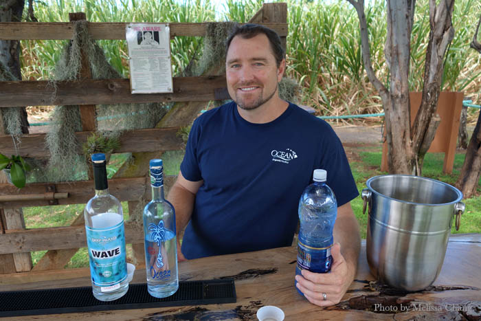 Ocean Vodka's Shay Smith on the farm with the distilled spirits.