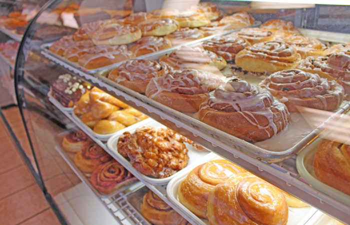 The second case holds an impressive selection of cinnamon rolls, apple fritters and specialty donuts including a peanut butter-filled one.