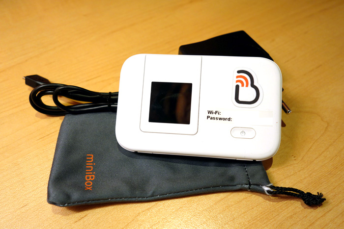 The Bienvenue pocket mifi comes with a carrying case and charger cord.
