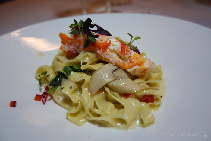 Butter poached king crab on porcini linguini at Sansei.