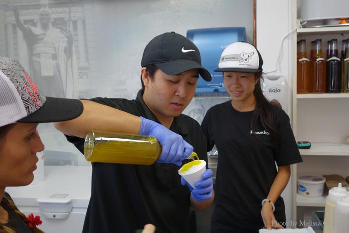 Kendall Shimazu pouring us a taste of the half-ripe mango.